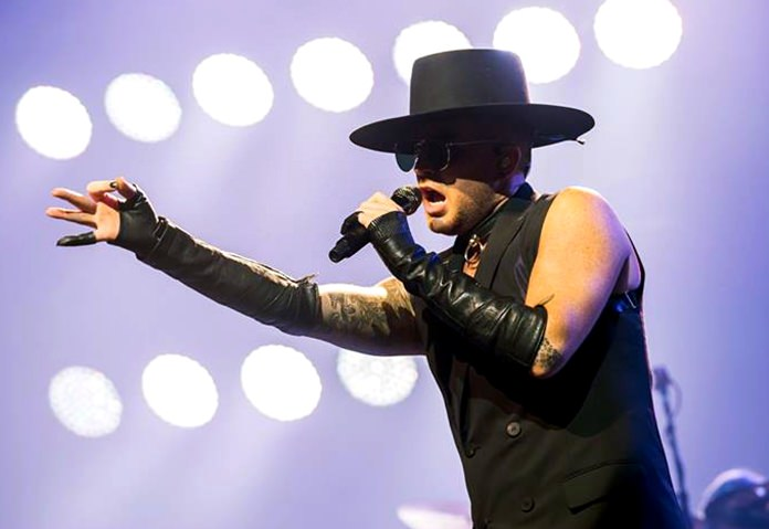 Adam Lambert gave a fine performance as lead singer with the band.