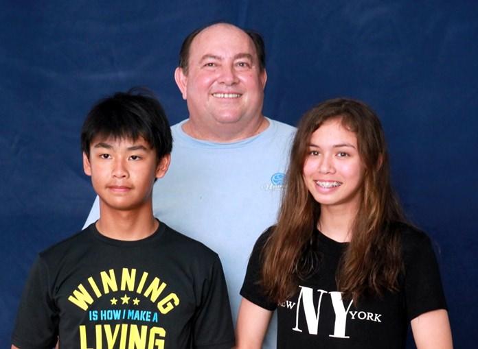 Laser 4.7 winners - Win Thanatayaudom (left) and Sophia Montgomery (right) with Varuna Commodore Tom Whitcraft.
