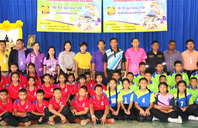 Students, teachers and public officials pose for a photo during the volleyball event at Sattahip School, Oct.6.