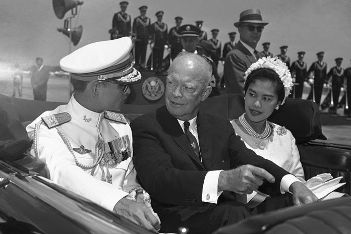 In this June 28, 1960, file photo, U.S. President Dwight Eisenhower, center, is seated between His Majesty King Bhumibol Adulyadej, left, and Her Majesty Queen Sirikit for a motorcade drive from National Airport to the White House in Washington. (AP Photo, File)