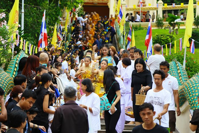 "Monks and lay people alike take part in the Tak Bat Devo procession down the hill depicting the path Buddha took down a ""celestial stairway"" made of silver, gold and crystal."
