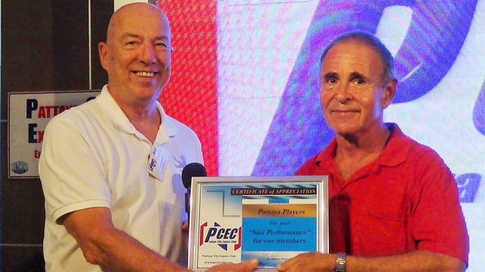 Sheldon Penner, on behalf of the Pattaya Players, accepts the PCEC's Certificate of Appreciation from MC Roy Albiston.