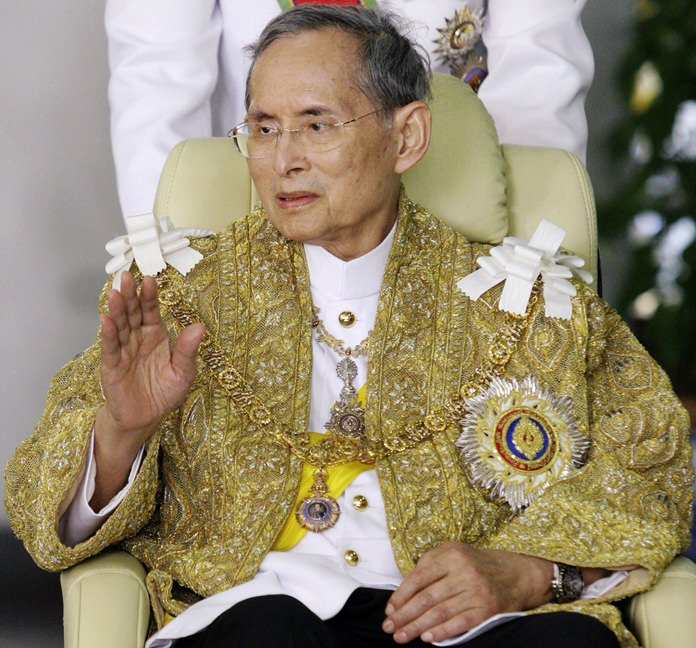 In this Dec. 5, 2010, file photo, HM King Bhumibol Adulyadej waves to well-wishers as he returns to Siriraj Hospital after attending a ceremony to celebrate his birthday in Bangkok. (AP Photo, File)