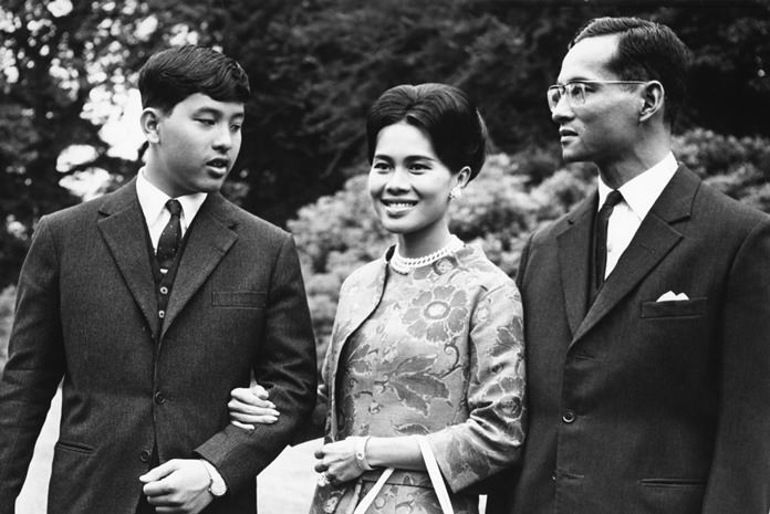 In this July 27, 1966, file photo, His Majesty King Bhumibol Adulyadej, right, walks with Her Majesty Queen Sirikit and their 13-year-old son, Crown Prince Vajiralongkorn, through the gardens of their residence at Sunninghill, Berkshire, where they were staying during their private visit to Britain. (AP Photo/Harris, File)