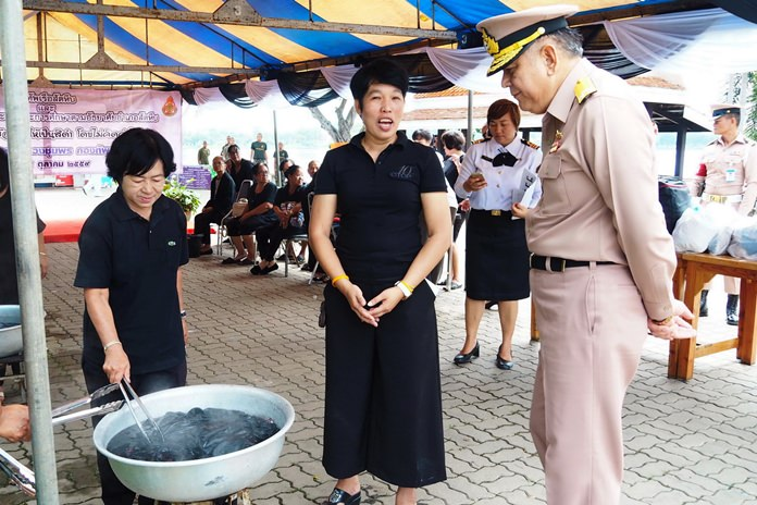 Royal Thai Navy officers are trading the deep blue sea for black dye, hoping to help ease the financial burden on those morning HM the King.