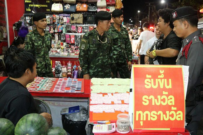 Police have arrested a Pattaya vendor for allegedly selling tickets for a variant of the illegal underground lottery that awards gold, not cash, as prizes.