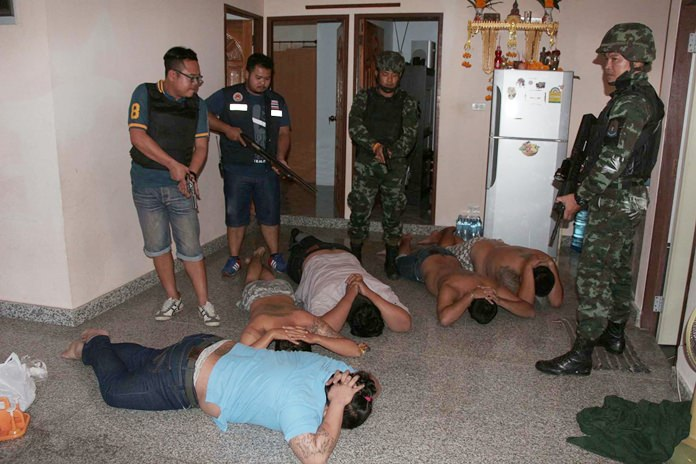 Police and military officers raided the Takhiantia home of an alleged loan shark and arrested five men who were said to be enforcers, some of whom were pictured on Facebook brandishing guns.