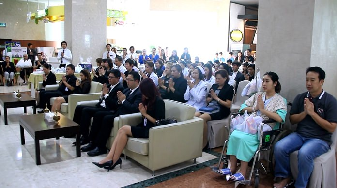 Many doctors, nurses, office staff, patients and friends solemnly take part in the ceremonies at Bangkok Hospital Pattaya.