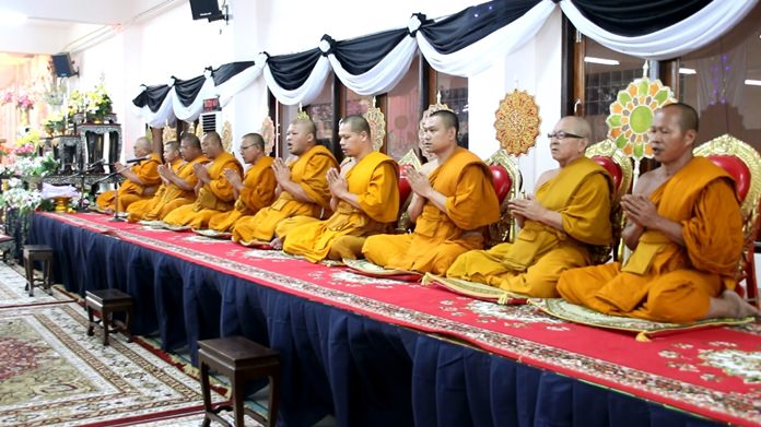 Revered monks chant holy funeral prayers at Wat Nongprue.