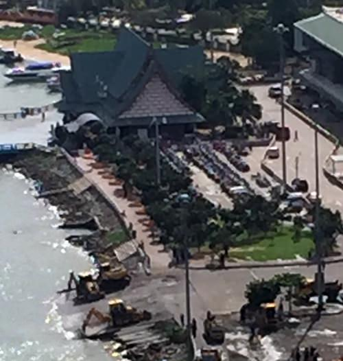 Heavy jack hammer equipment (lower left) break up the illegal boat ramp.