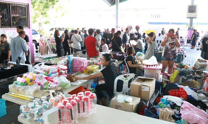 """Nongprue's already cheap open market became even a better deal Nov. 2 as merchants offered free products and services to """"do good for Dad""""."""