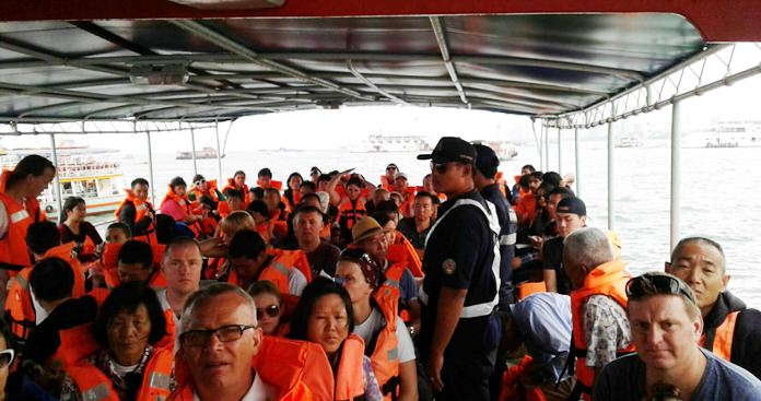 Koh Larn ferries finally are complying with safety regulations by keeping passenger numbers down and requiring everyone to wear life vests, Pattaya officials said.