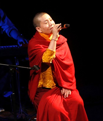 Buddhist nun and musician Ani Choying Drolma performs during a concert in Mumbai, India, Oct. 7, 2016. (AP Photo/Rajanish Kakade)