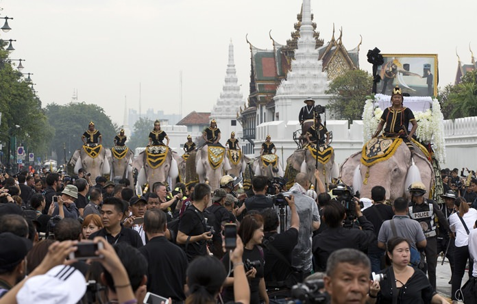 Mahouts lead a procession of 11 white elephants past the Grand Palace in honor of HM the late King Bhumibol Adulyadej. (AP Photo/Mark Baker, File)