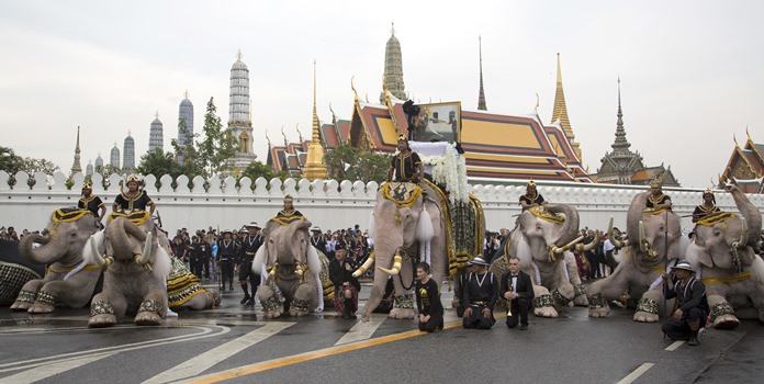 Mahouts lead white elephants to kneel in front of the Grand Palace. (AP Photo/Mark Baker)