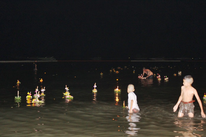 As is tradition, young boys swim out to collect the coins people put into their Krathongs.