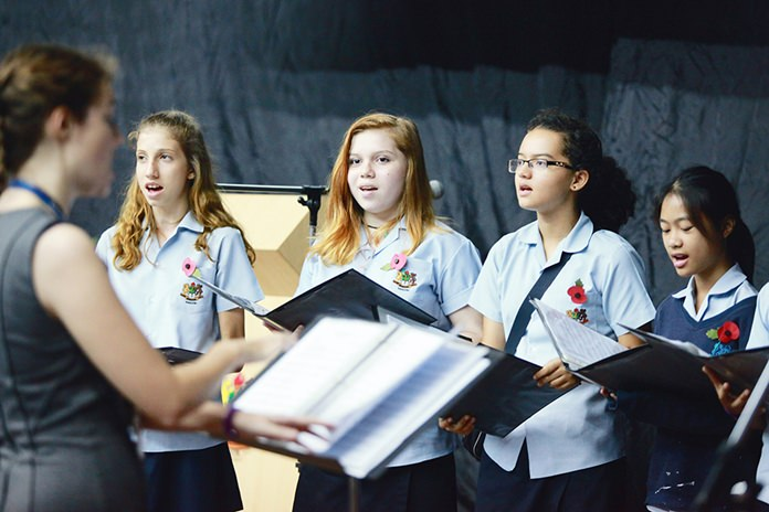 The Chamber Choir performs a version of In Flanders Fields