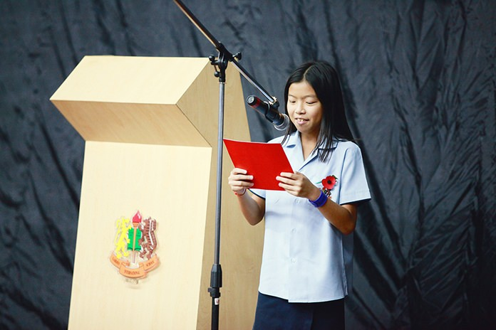 A Primary student reads a poem at the service.