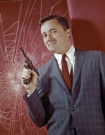 """Actor Robert Vaughn is shown portraying superspy Napoleon Solo in this undated press photo for television's """"The Man From U.N.C.L.E"""" series. (AP Photo, File)"""