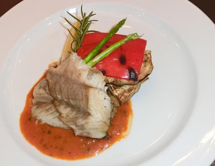Pan-fried fish and sweet masala sauce. (Photo by Marisa Corness)