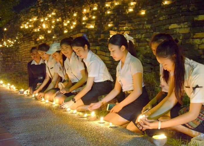 Students and other members of local organizations lit 49,999 candles around the city walls, gates and moat.