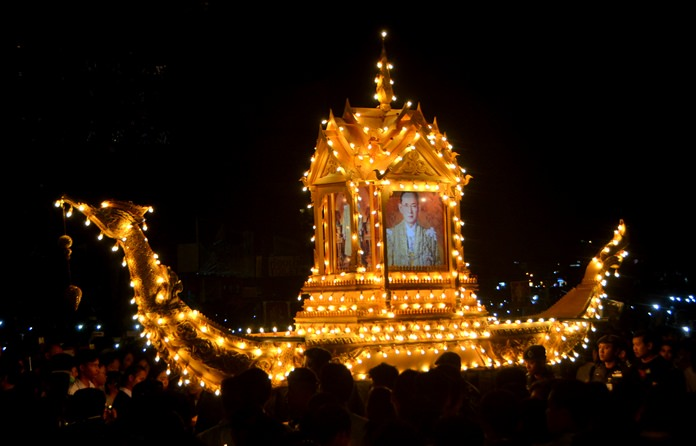 The golden Suwannahong 'royal barge' bearing the portrait of HM the King seems to float though the crowd as it is carried onto the stage.
