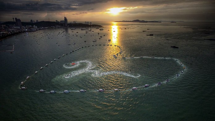 Some of the 1,000 + boats and jet skis that took part in the event create a massive heart and Thai number 9 to honor King Rama IX.