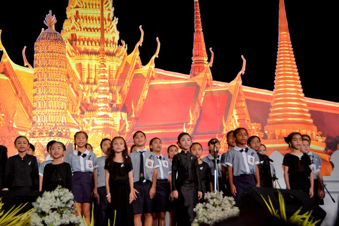 Children sing songs of praise and remembrance for our beloved father.