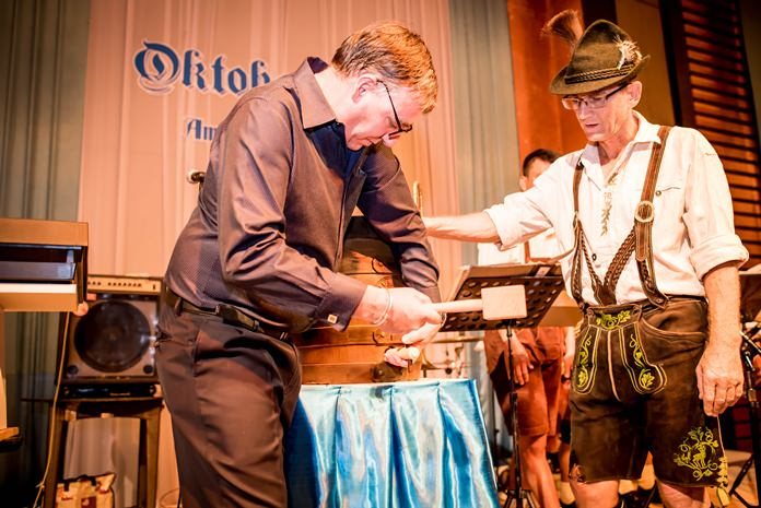 Richard Gamlin, resident manager of Amari Pattaya (left) 'taps' the beer barrel to officially get the Oktoberfest underway.