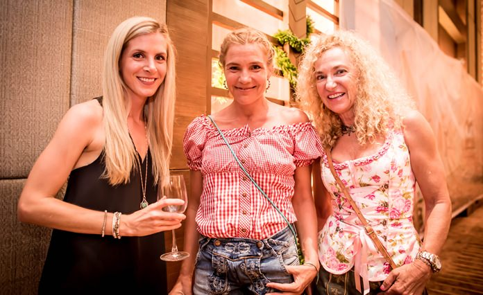 A trio of smiles at Oktoberfest Pattaya.