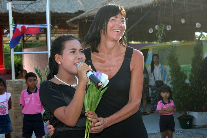 Renee de Vaan-Goosen joins a girl from the Child Development and Protection Center during her rendition of 'You raise me up'.