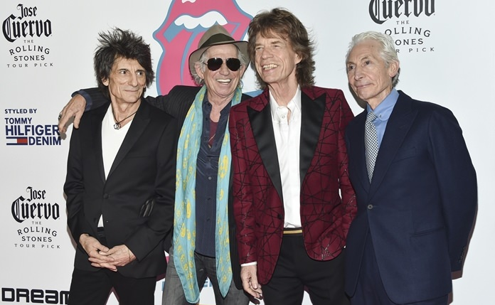 "The Rolling Stones (from left) Ronnie Wood, Keith Richards, Mick Jagger and Charlie Watts attend the opening night party for ""Exhibitionism"" at Industria on Tuesday, Nov. 15, in New York. (Photo by Evan Agostini/Invision/AP)"