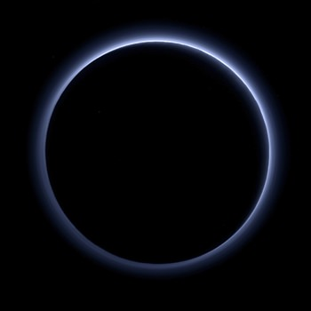 This image released by NASA on Thursday, Oct. 8, 2015 shows a haze layer surrounding Pluto, photographed by the New Horizons spacecraft. On Friday, Oct. 28, 2016, NASA said the spacecraft has sent back the last bit of data collected from its July 14, 2015 flyby. It took more than five hours for the image to reach Earth from NASA's New Horizons spacecraft, some 3 billion miles away. (NASA/JHUAPL/SwRI via AP)