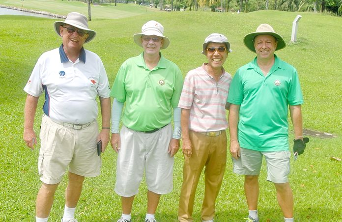 Tropical golfers pose for a photo during their round at Khao Kheow.