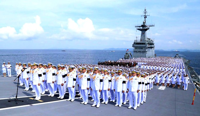 About 2,500 sailors sang the royal anthem in tribute to HM the late King aboard the HTMS Chakri Naruebet.