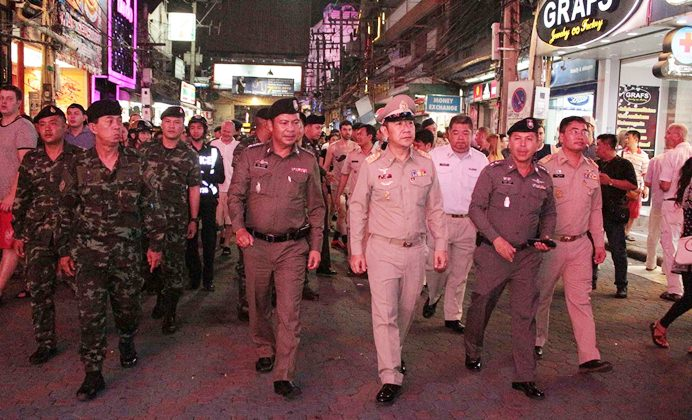 Banglamung's new district chief Naris Miramaiwong led a contingent of district officials, Tourist and Pattaya police, and soldiers on a tour of Walking Street for a safety check through the nightlife district.