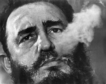In this March 1985 file photo, Cuba's leader Fidel Castro exhales cigar smoke during an interview at the presidential palace in Havana, Cuba. (AP Photo/Charles Tasnadi, File)