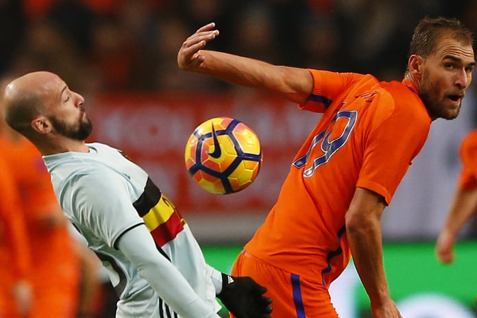 Belgium's Laurent Ciman, left, and Netherlands' Bas Dost vie for the ball during their teams' international friendly match at the ArenA stadium in Amsterdam, Netherlands, Wednesday, Nov. 9. (AP Photo/Peter Dejong)