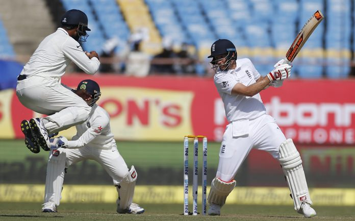 England batsman Joe Root plays a shot during the first day of the first test against India in Rajkot, India, Wednesday, Nov. 9. (AP Photo/Rafiq Maqbool)