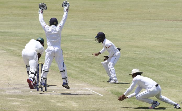 Sri Lankan players appeal for the wicket of Zimbabwe batsman Carl Mumba during the final day of the second at the Harare Sports Club in Harare, Thursday, Nov. 10. (AP Photo/Tsvangirayi Mukwazhi)