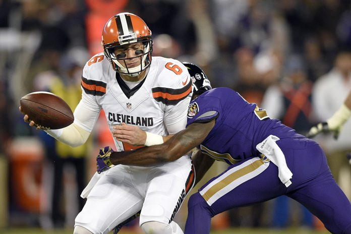 Cleveland Browns quarterback Cody Kessler, left, is sacked by Baltimore Ravens free safety Lardarius Webb during the first half their NFL football game, Thursday, Nov. 10, in Baltimore. (AP Photo/Nick Wass)