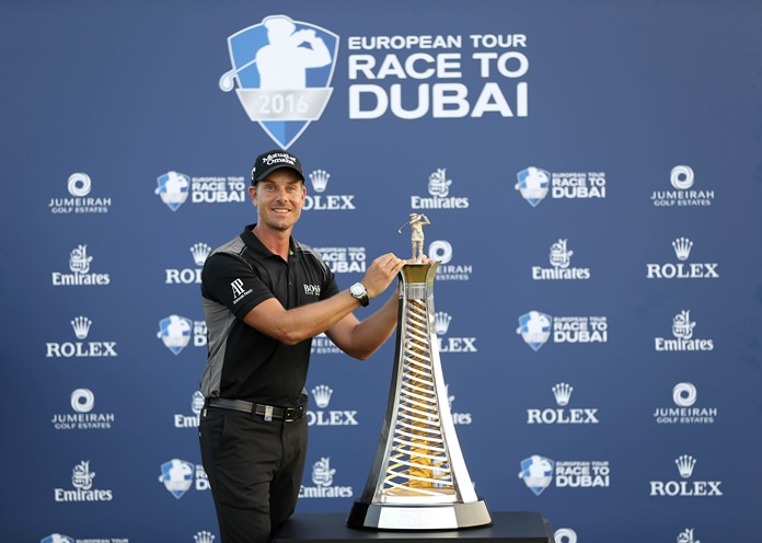 Henrik Stenson poses with the trophy after he won the Race to Dubai at the Jumeirah Golf Estates in Dubai, United Arab Emirates, Sunday, Nov. 20. (AP Photo/Kamran Jebreili)