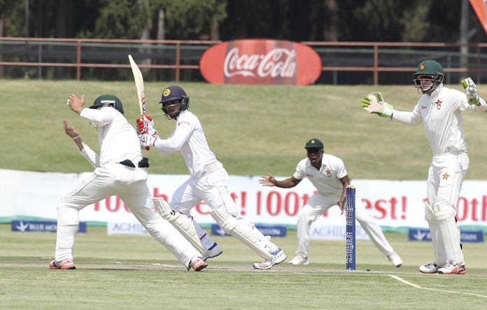 Sri Lankan batsman Dimuth Karunaratne plays a shot during the first test against Zimbabwe in Harare, Tuesday, Nov, 1. (AP Photo/Tsvangirayi Mukwazhi)
