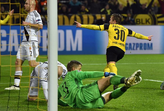 Borussia Dortmund's Felix Passlack, right, celebrates after scoring his side's 7th goal during their Champions League Group F match against Legia Warsaw in Dortmund, Germany, Tuesday, Nov. 22. (AP Photo/Martin Meissner)