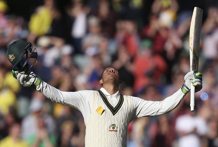 Australia's Usman Khawaja celebrates making 100 runs against South Africa during the third test in Adelaide, Australia, Friday, Nov. 25. (AP Photo/Rick Rycroft)