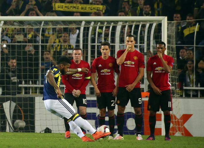 Fenerbahce's Jeremain Lens, left, scores from a free kick against Manchester United during their Europa League group A match in Istanbul, Thursday, Nov. 3. (AP Photo