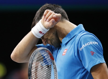 Novak Djokovic of Serbia reacts after losing a point against Marin Cilic of Croatia during their quarterfinal match at the Paris Masters tennis tournament in Paris, Friday, Nov. 4. (AP Photo/Michel Euler)