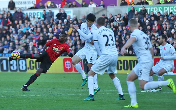 Manchester United's Paul Pogba scores his side's first goal during their Premier League match against Swansea City at the Liberty Stadium in Swansea, Wales. Sunday Nov 6. (Nick Potts/PA via AP)