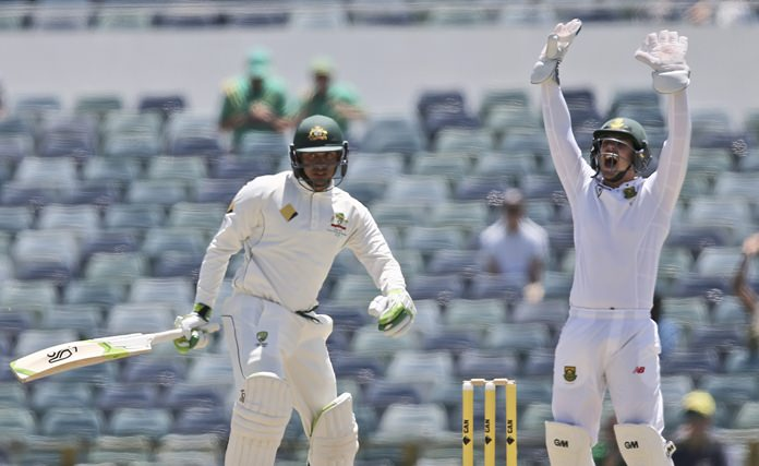 South Africa's Quinton de Kock, right, appeals for the wicket of Australia's Usman Khawaja during the fifth day of the first test in Perth, Western Australia, Monday, Nov. 7. (AP Photo/Rob Griffith)
