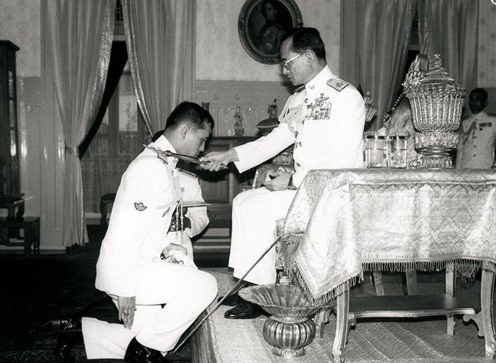 HM King Rama IX decorates HRH Crown Prince Maha Vajiralongkorn with badges of Rear Admiral and Air Vice Marshal in a ranking ceremony on September 10, 1987.